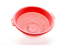 Kitchen sieve. Red plastic kitchen sieve exempted Royalty Free Stock Images