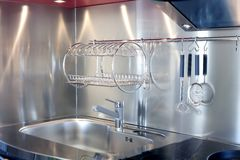 Kitchen silver sink and vitroceramic stove hob. Modern decoration Stock Photos