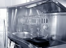 Kitchen silver sink and vitroceramic stove hob Stock Images