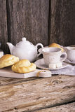 Kitchen simple still life of tea, cup, white sugar lump in a bank and fresh homemade cakes Royalty Free Stock Photos