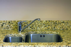 Kitchen sink. Stainless steel double sink with stone worktop stock images