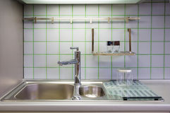 Kitchen sink. With accessories and ceramic squares on the wall royalty free stock image