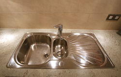 Kitchen Sink. Stainless steel kitchen sink with 1.5 bowl arrangement and mixer tap Royalty Free Stock Photography