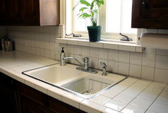 Kitchen Sink 2. A kitchen sink sits under a bright window and sparkles with cleanness Stock Photos