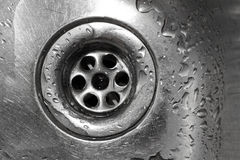 Kitchen sink. Metallic Kitchen sink with water drops shot from from above Royalty Free Stock Photos