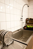 Kitchen and sink. Stainless steel kitchen with sink and food Royalty Free Stock Photography