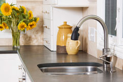 Kitchen sink. A kitchen sink in a luxury new home royalty free stock photos