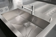Kitchen sink. Angle view of kitchen sink and silver faucet stock photos