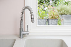 Kitchen sink. With plants in the background stock photography