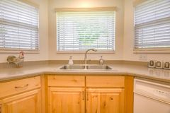 Kitchen sink with bay windows in model home. In Utah Valley royalty free stock photos
