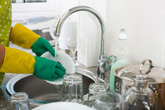 Kitchen sink with being washed. View on pure kitchen sink with white crockery being washed royalty free stock images