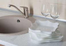 Kitchen sink with clean dishware stock photos