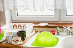 Kitchen sink with dirty dishes. In it. Home interior, household duties objects concept royalty free stock image