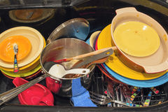 Kitchen Sink with Dirty Dishes Utensils and Pot Stock Photo