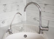 Kitchen sink with drinking purified water tap through filter and tap tap with tap water.  stock photography