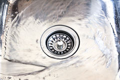 A kitchen sink. With drops stock photography