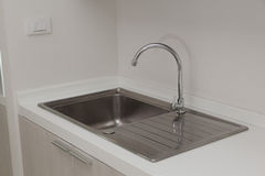 Kitchen sink. And the faucet royalty free stock photo