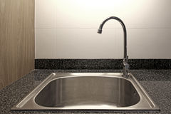 Kitchen sink and faucet. On marble counter royalty free stock images