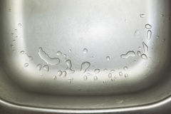 Kitchen sink fragment. Close up fragment of stainless steel kitchen sink stock photography