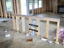Kitchen Sink Frame Work. Framing and PVC piping, plumbing and hoses for the installation of a island style kitchen sink Royalty Free Stock Image