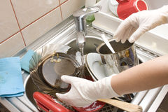 Kitchen sink full with dishes Stock Photos