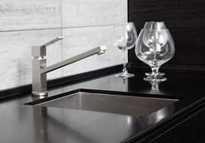 Kitchen sink with metal tap Stock Image