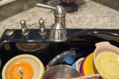 Kitchen Sink with Out of Focus Dirty Dishes Royalty Free Stock Images