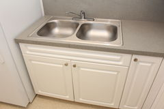 Kitchen sink. A picture of a kitchen sink royalty free stock photography