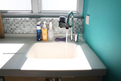Kitchen sink and running water Royalty Free Stock Photo