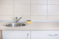 Kitchen sink with sponge Royalty Free Stock Photo