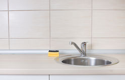 Kitchen sink with sponge Royalty Free Stock Images