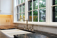 Kitchen sink with a view. Luxury kitchen sink with a view Royalty Free Stock Image