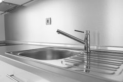 Kitchen sink and water tap. Kitchen sink and water tap in the kitchen royalty free stock photos