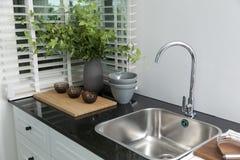 Kitchen sink. White kitchen sink at home stock photography