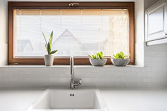 Kitchen with sink and window. Kitchen with white sink, countertop and window royalty free stock photos