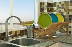 Kitchen sink with wooden plate rack Stock Photos
