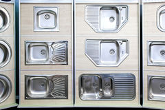 Kitchen sinks. Display of stainless steel kitchen sinks samples stock images