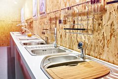 Kitchen sinks and faucets in store. Kitchen sinks and faucets in the store stock photography