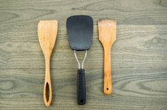 Kitchen spatulas on aged wood Stock Photo