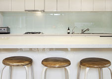 Kitchen splashback bench and stools Stock Photo