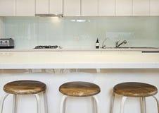 Kitchen splashback bench and stools. Kitchen benchtop, splashback and stools contemporary stock photo