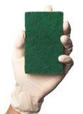 Kitchen sponge. Hand in rubber gloves holding a kitchen sponge stock images