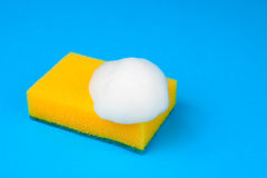 Kitchen sponge with foam. Kitchen sponge yellow with white foam lies Stock Photography