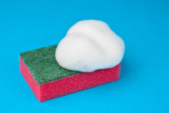 Kitchen sponge red with foam. Lies on blue background Stock Photography
