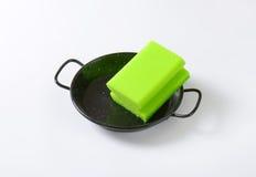 Kitchen sponge on skillet Stock Photos