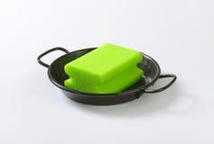 Kitchen sponge on skillet Stock Photography