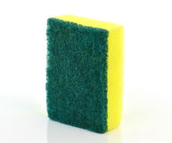 A kitchen sponge on the white background Royalty Free Stock Image