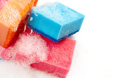 Kitchen sponges in foam Royalty Free Stock Images
