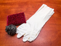 Kitchen sponges and gloves Royalty Free Stock Photos