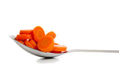 A kitchen spoon full of sliced carrots Royalty Free Stock Photography